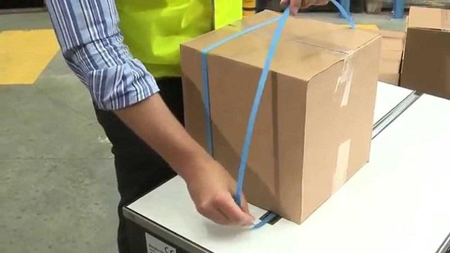 Máy đóng đai thùng carton